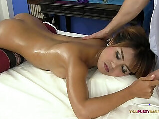 Asian with shaved pussy receives oil massage