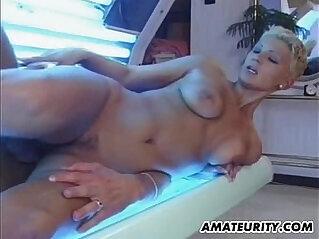 Busty amateur blonde girlfriend sucks and fucks in a solarium