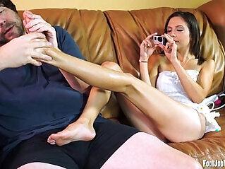 Sexy girl gives footjob and masturbates