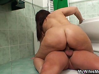 Busty mom in law riding black cock in the bathroom