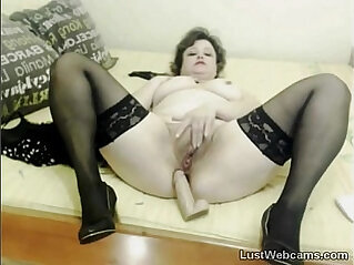 Mature in stockings toys pussy on cam